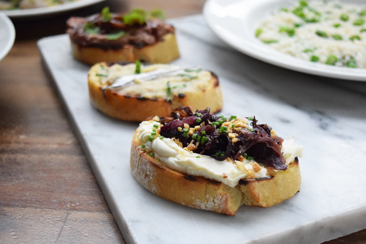 Crostini with ricotta, red onions, and hazelnuts at Eataly