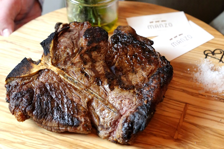 Porterhouse steak at Manzo, a butcher's restaurant in NYC