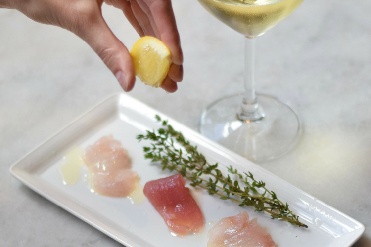 ech-seafood-pesce-crudo-wine-lemon-hands