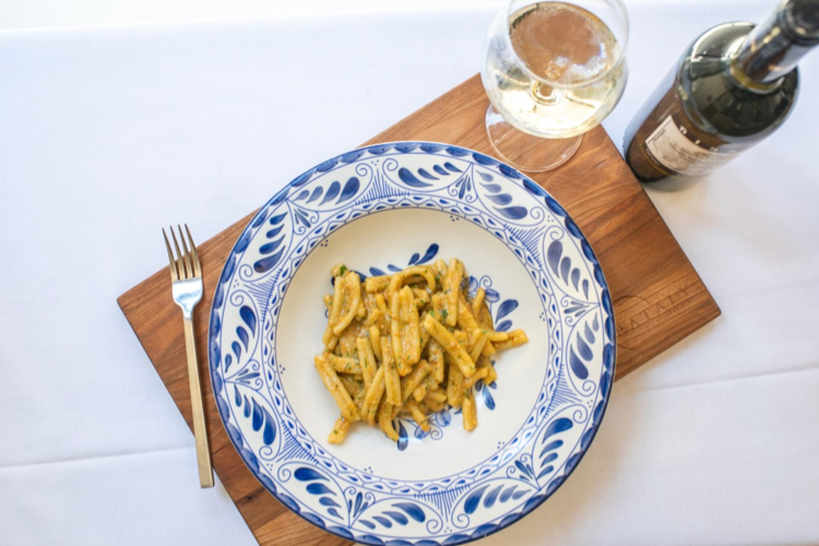 Pasta with red pesto and wine at Eataly