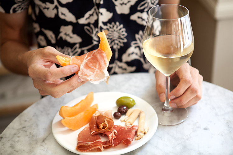 Prosciutto crudo and wine pairing with antipasti at Eataly