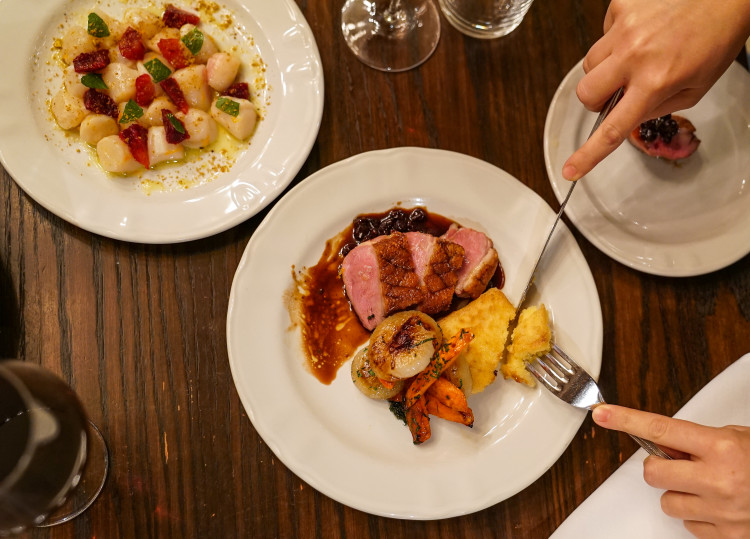 Roast duck with polenta and scallops