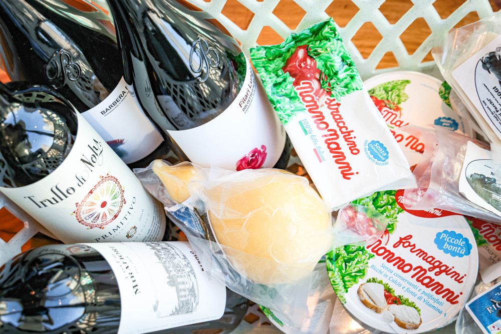 Shopping cart with Italian wine and cheeses